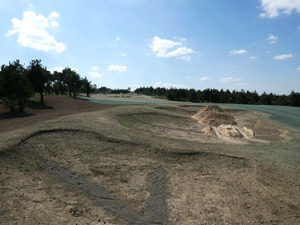 Looking forward behind first fairway bunkers on long uphill par 5 seventh