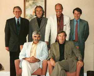 Howard Swan, Rainer Preissmann, Peter Harradine and Mark Adam (back row), Jeremy Pern and Alain Prat (sitting), at a pre-merger meeting